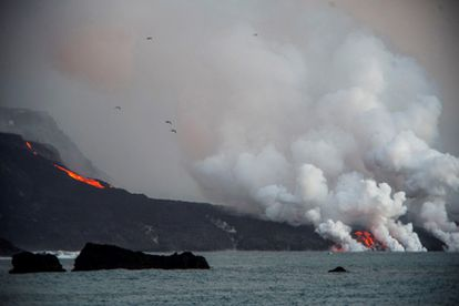 Lava flow from the volcano falling into the sea on the coast of Tazacorte, on La Palma, on Wednesday.