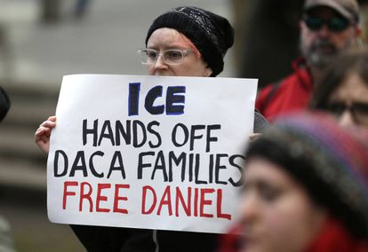 A woman protests on behalf of Daniel Ramírez in Seattle.