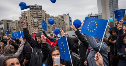 Romanians march with European Union flags in Bucharest in March.