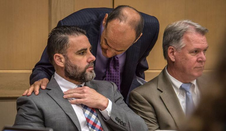 Pablo Ibar speaks to his lawyer in a Florida court on Monday.