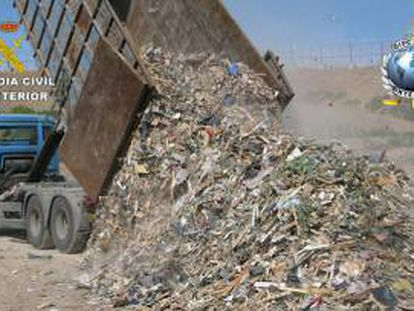 A truck dumping garbage illegally.