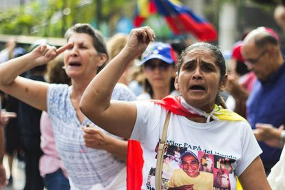 People protest during a demonstration against the blackout and the Nicolás Maduro government.