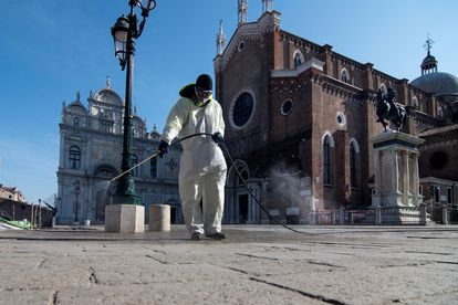 A worker disinfects Piazza San Marco in Venice.