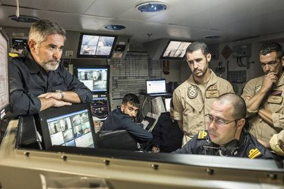The crew analyzing real-time images on their screens.