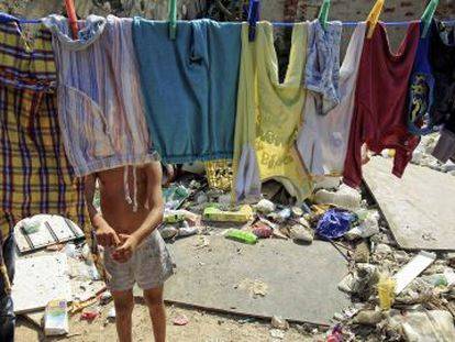 Washing day in Cañada Real. The Madrid shanty town is the largest in Europe.