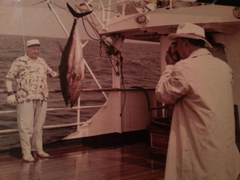Francisco Franco takes a picture of Andrés Zala with a tuna he caught aboard the dictator's yacht Azor.