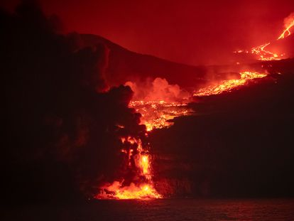 The lava from the volcano reaches the sea.