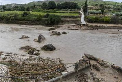 A centuries-oldl bridge has been completely wiped out.