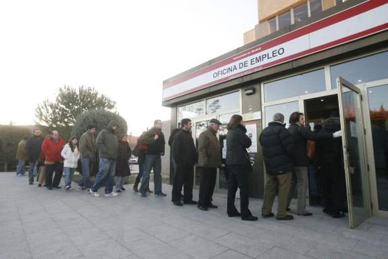 People wait in line at a labor center in the Madrid neighborhood of Moratalaz.