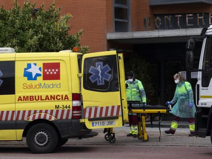 An ambulance taking people out of the Monte Hermoso senior residence in Madrid.