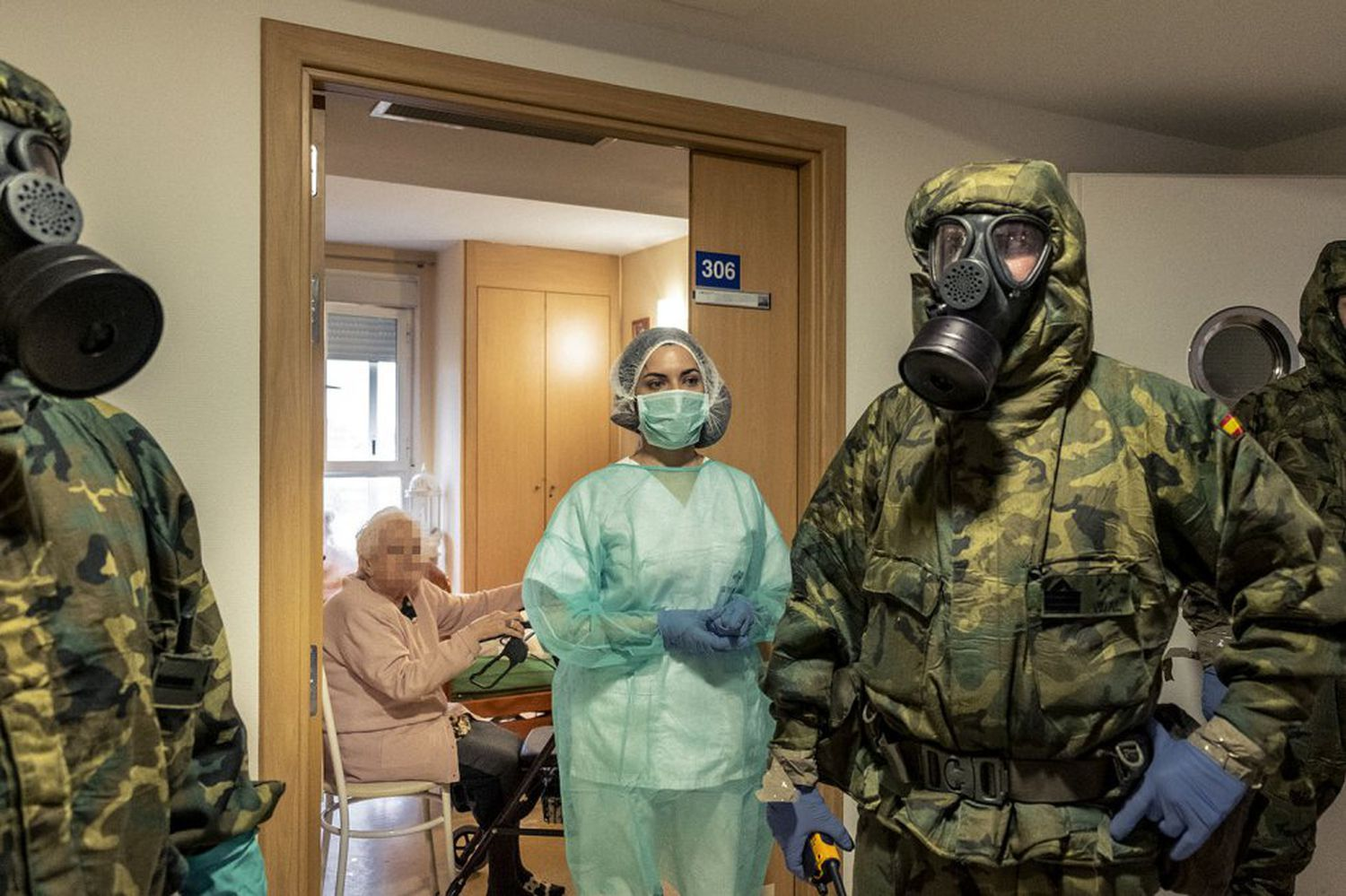 Soldiers from the Alcalá de Henares Parachute Brigade stationed on the outskirts of Madrid, arrive with their NBC (nuclear, biological and chemical) defense equipment to disinfect a seniors residence.