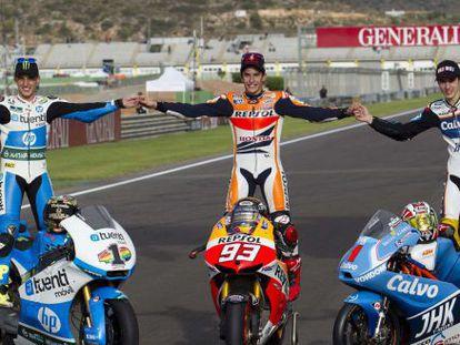 World Champions Repsol Honda Team's Marc Marquez (c), Tuenti HP 40's Moto2 rider Pol Espargaró (l) and Team Calvo's Spanish Moto3 rider Maverick Vinales.