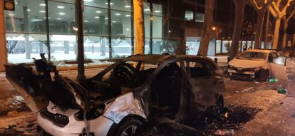 Burned-out cars in front of the Fira convention center on Saturday.