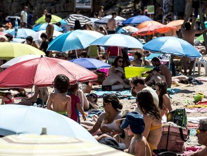 A busy beach on the Costa Brava.