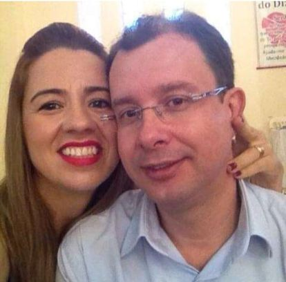 Professor Dalton Milagres Rigueira and his wife Valdirene Lopes in a 2014 photo posted on Facebook. Madalena was rescued from their home in Patos de Minas.