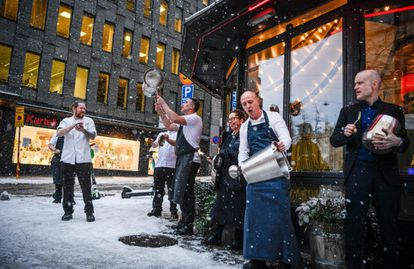 Restaurant workers protest against coronavirus restrictions outside a restaurant in Stockholm on January 14.