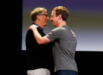 Gates hugs Mark Zuckerberg during the latter's announcement of an initiative to cure and prevent diseases last September.