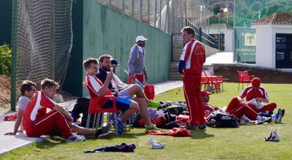 Madrid Cricket Club players wait their turn to bat during a march in La Manga.