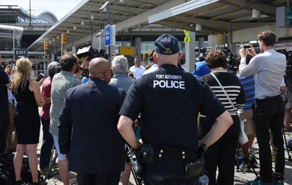 Opponents of the travel ban stage a protest at JFK airport.