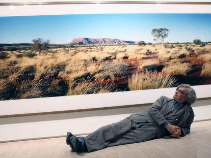 Wim Wenders poses with one of his images at the Fundación Sorigué.