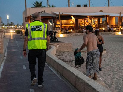 A police officer patrolling a beach in Palma, on the island of Mallorca.