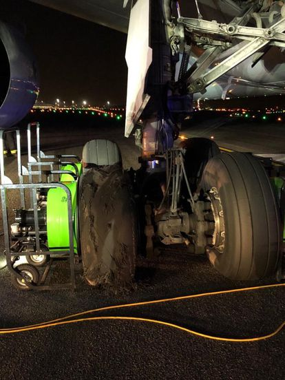 The tire that was damaged during takeoff.