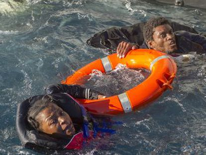 Two would-be immigrants traveling in an overcrowded plastic boat are rescued in the Strait on Monday