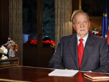 Spanish King Juan Carlos looks on during his annual Christmas Eve message at the Zarzuela Palace in Madrid.
