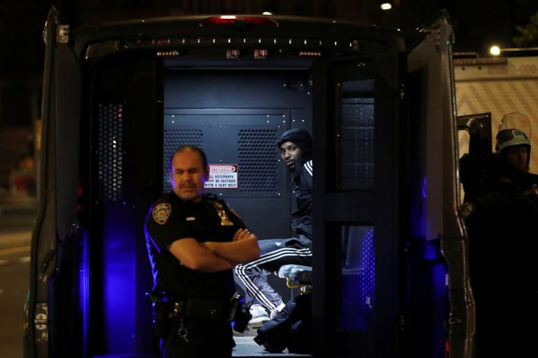 A protestor in a police van after being arrested during demonstrations in New York last week.