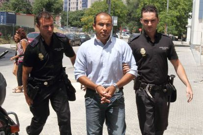 Hokman Joma is taken to court in Seville by police officers in June 2010.