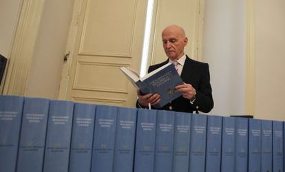 Royal History Academy head Gonzalo Anes in his office alongside an edition of the Spanish Biographical Dictionary.