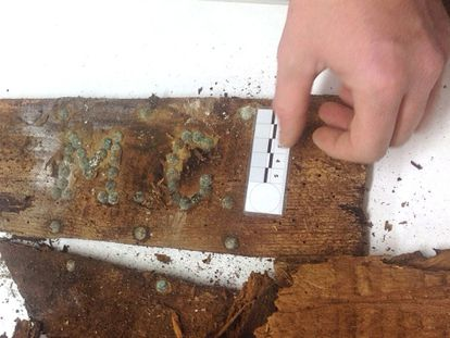 """Remains of a coffin marked with the initials """"M. C."""" found at Cervantes' burial place."""