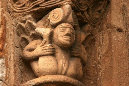 A woman showing her sexual organs on a capital at the Collegiate Church of San Pedro de Cervatos (Cantabria).