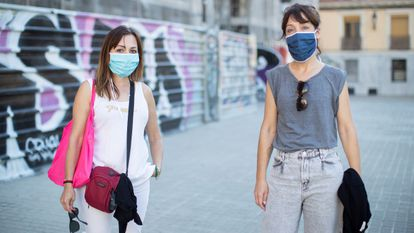 Two women wearing face masks in Barcelona on Tuesday.