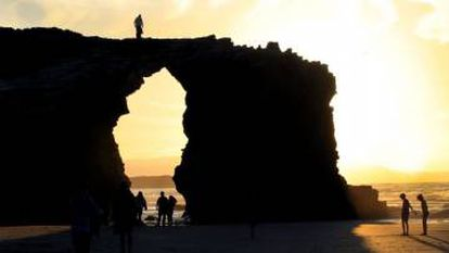 A tourist on top of one of the cliffs in an image from the regional government's report.