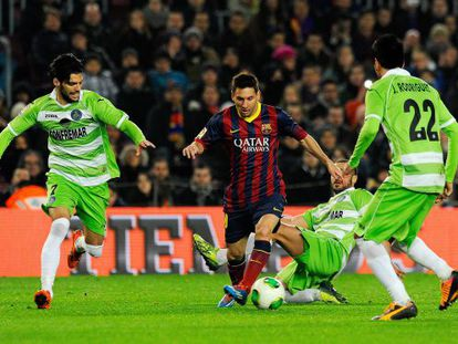 Leo Messi rides the challenges of Getafe during Wednesday's King's Cup match.