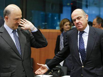 EU Commissioner for Economic Affairs Pierre Moscovici with Spanish Economy Minister Luis de Guindos.