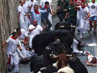 Animals from the Puerto de San Lorenzo stockbreeder were the first to run the streets of the city during the world-famous fiestas, which were slippery after early morning rain