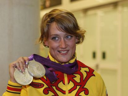 Mireia Belmonte shows off her silver medals at the London Olympics.