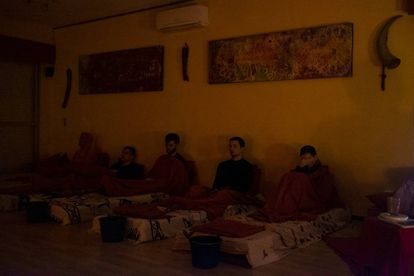 The participants relax as they wait for the effects of the first ayahuasca shot.