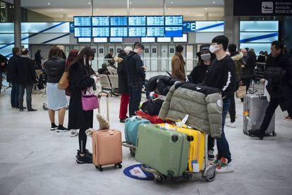 Passengers arrive in France from Beijing.