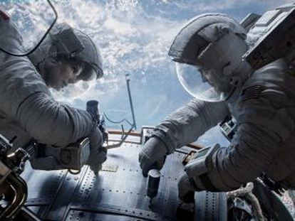 Sandra Bullock and George Clooney in Alfonso Cuarón's Gravity.