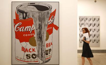 A visitor next to Warhol's 'Big Torn Campbell's Soup Can.'