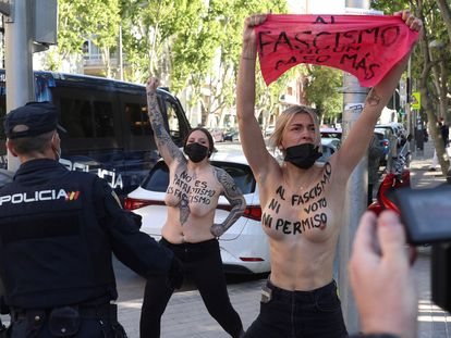 Femen activists protesting outside the voting station where Vox candidate Rocío Monasterio was expected to cast her ballot.