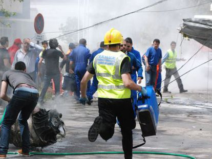 An emergency medic rushes to the scene of the fatal crash on Sunday at the Cuatro Vientos airport in Madrid.