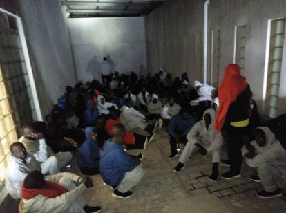 Migrants crowd in a police station in Algeciras.