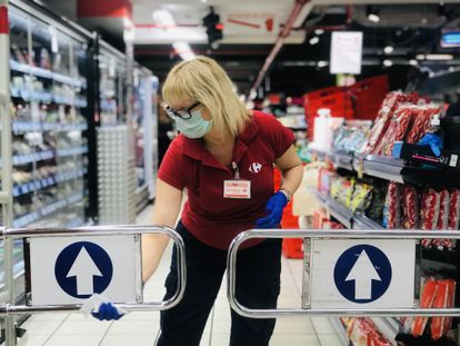 A worker disinfects a supermarket in March 2020.