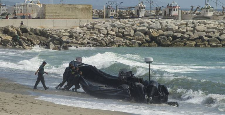Civil guards push a speedboat used by drug gangs in the Strait of Gibraltar.