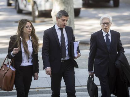 Leo Messi's defense team arrive at court in Barcelona on Tuesday.