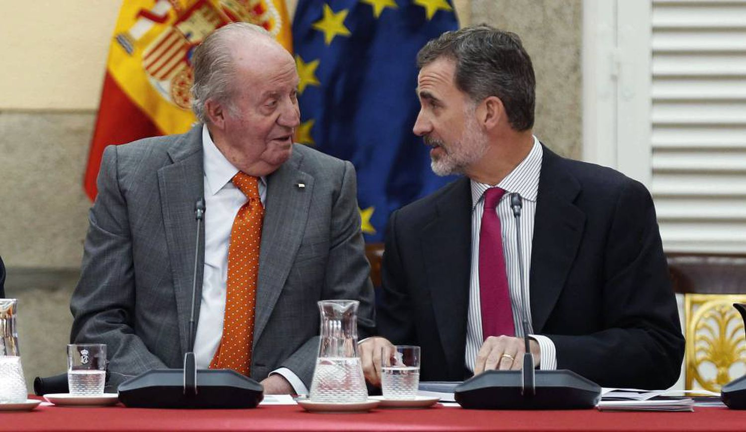Spain's emeritus king Juan Carlos I with his son, King Felipe VI, in a file photo from 2019.